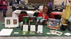 My booth at the start of the day. My table buddy and bestie Megan is already hard at work to convince people my books are worth the read ;)